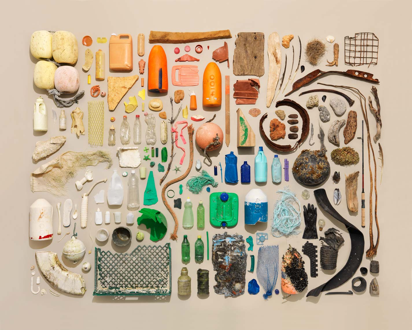 beach garbage organized from dark to light on tan paper
