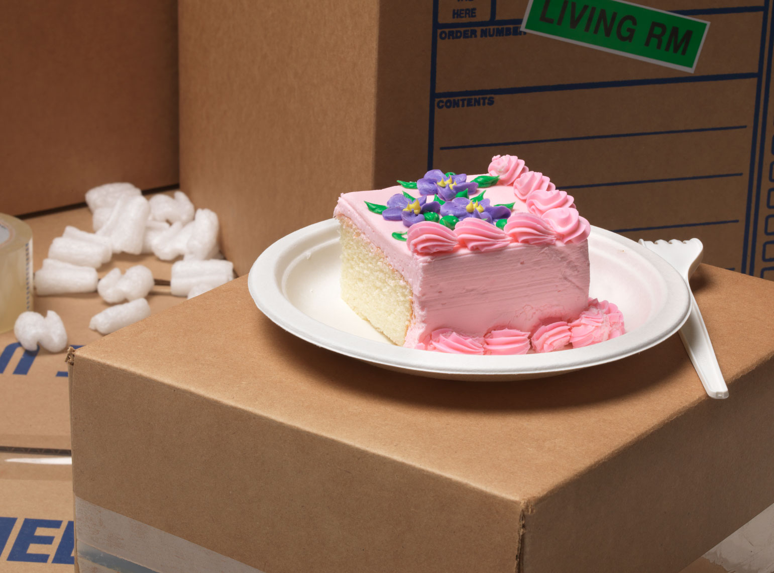 cake on moving boxes treat for working hard