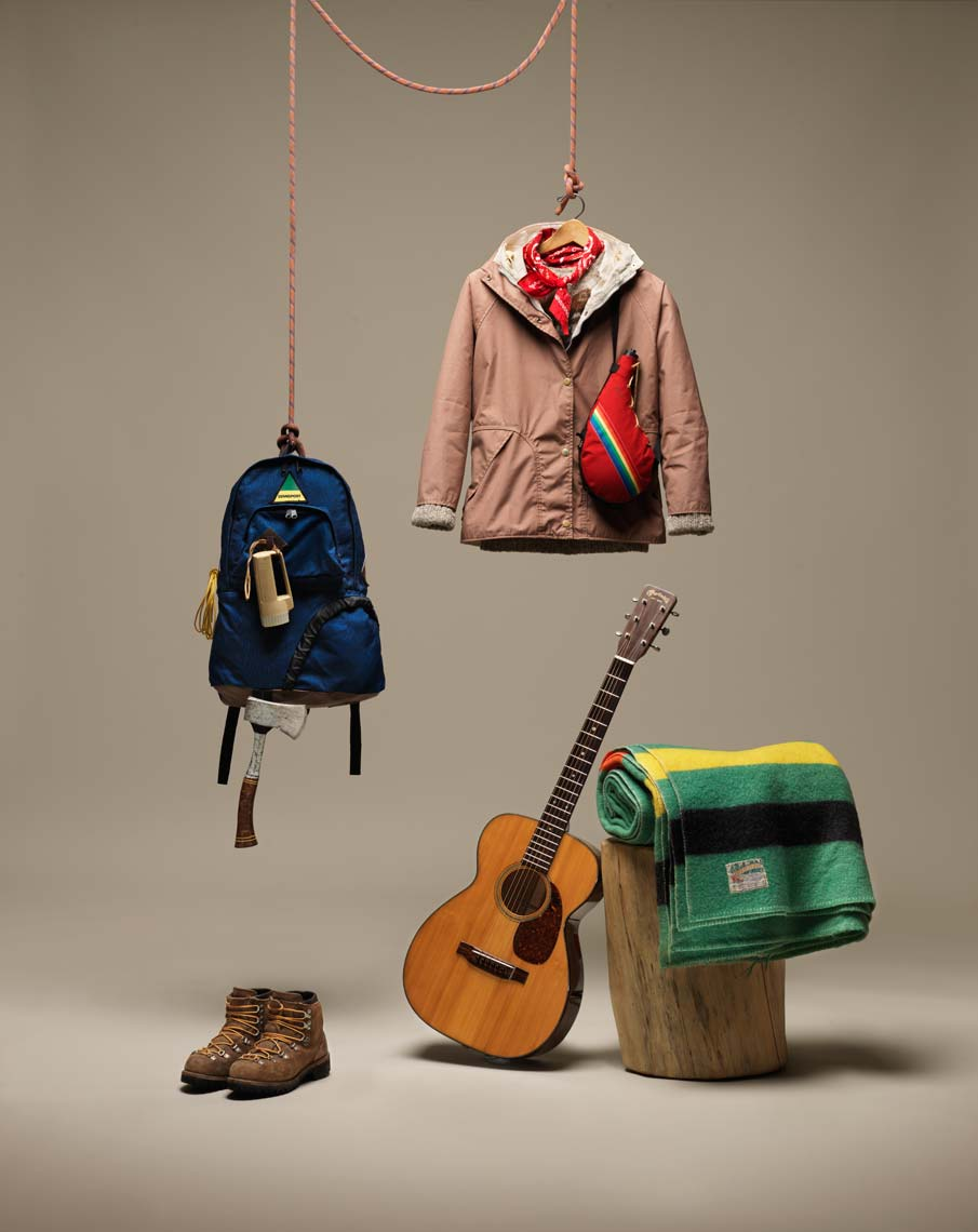 simple image of camping equipment and a guitar
