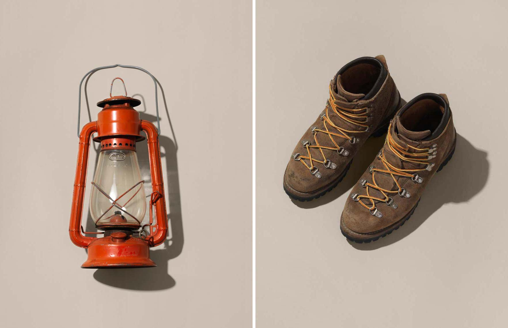old lantern and a worn pair of hiking boots