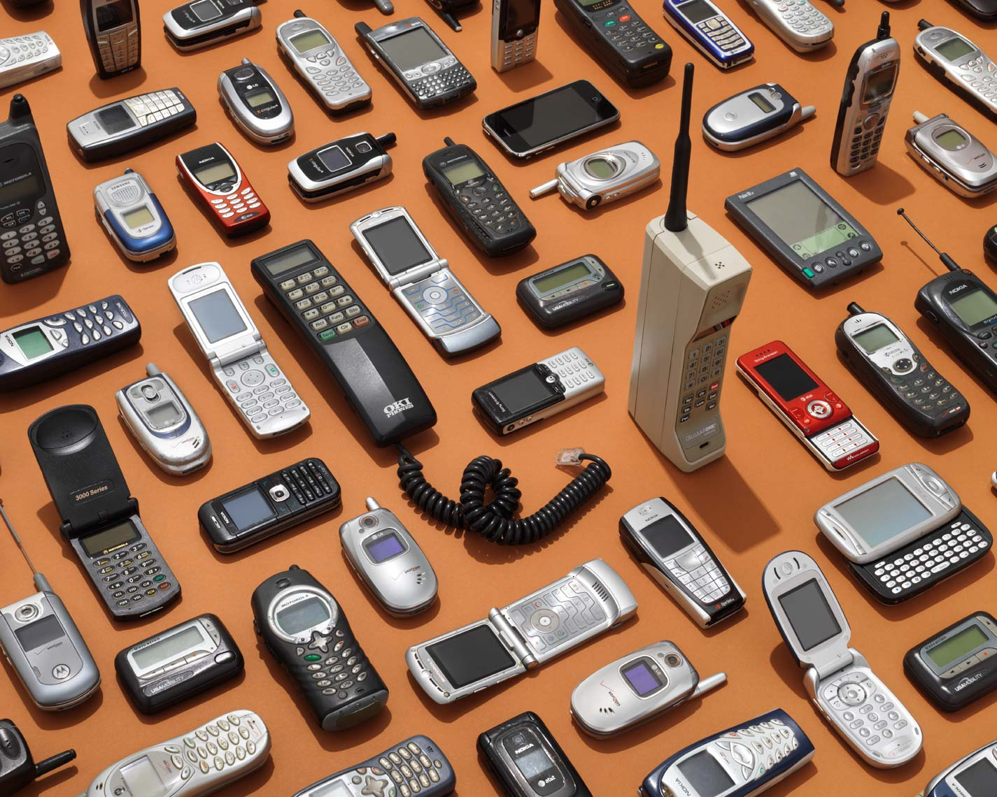 vintage cell phones organized neatly