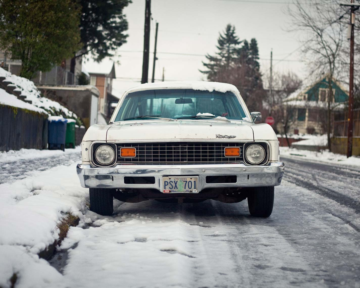 white chevy nova on a snowy portland block