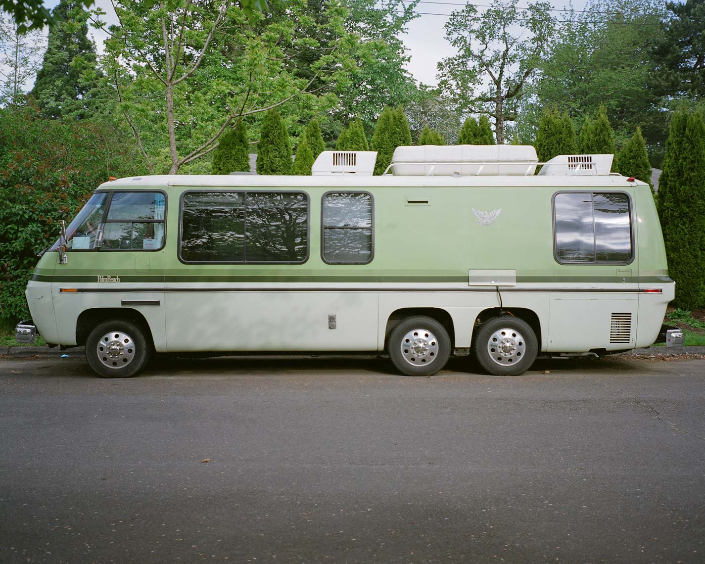 green GMC motorhome on an oregon street