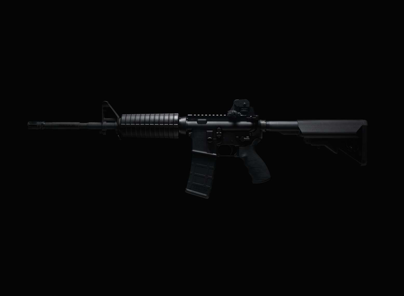 dark photo of an AR-15 rifle