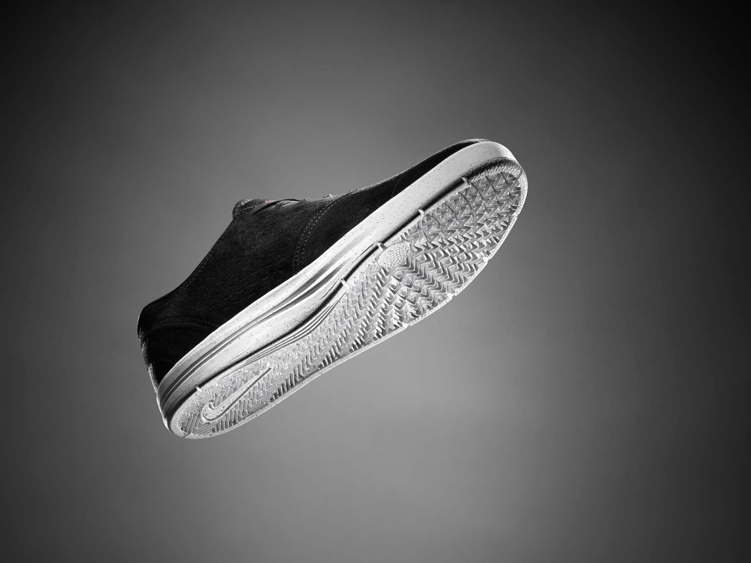 looking at a nikeSB Janoski shoe from below on a great background