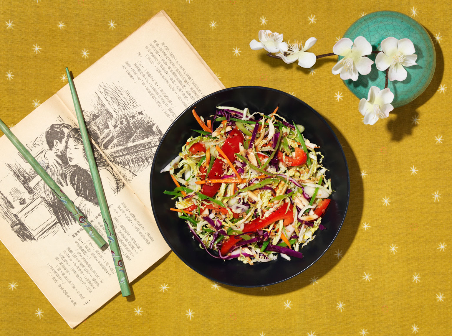 asian slaw with red peppers on mustard yellow placemat