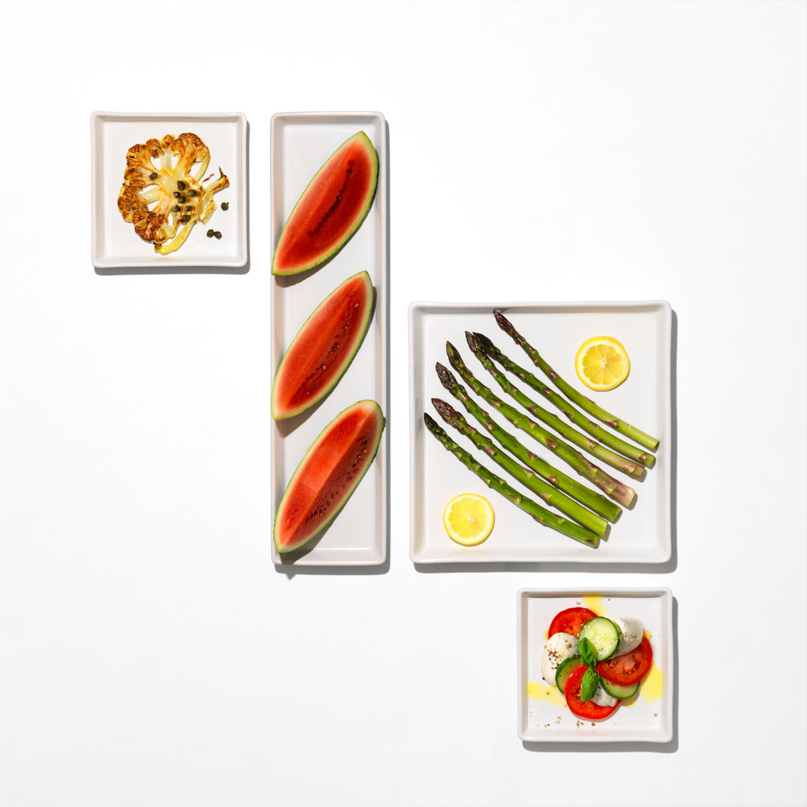 graphic arrangement of watermelon and asparagus on square plates