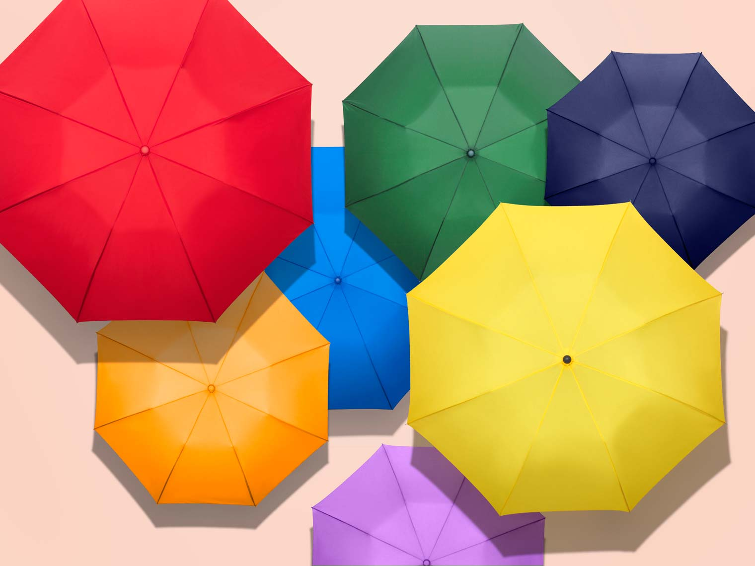 colorful umbrellas arranged in a graphic pattern