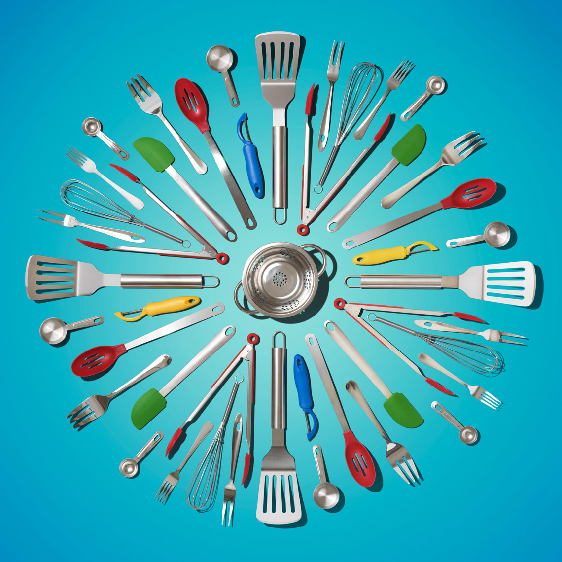 cooking utensils arranged in a mandala