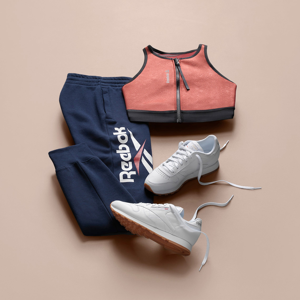 reebok classics workout outfit on a peach background