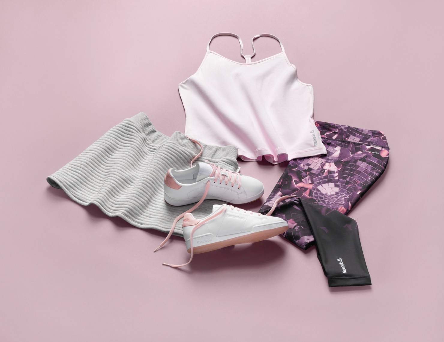 womens workout clothes on a pink background