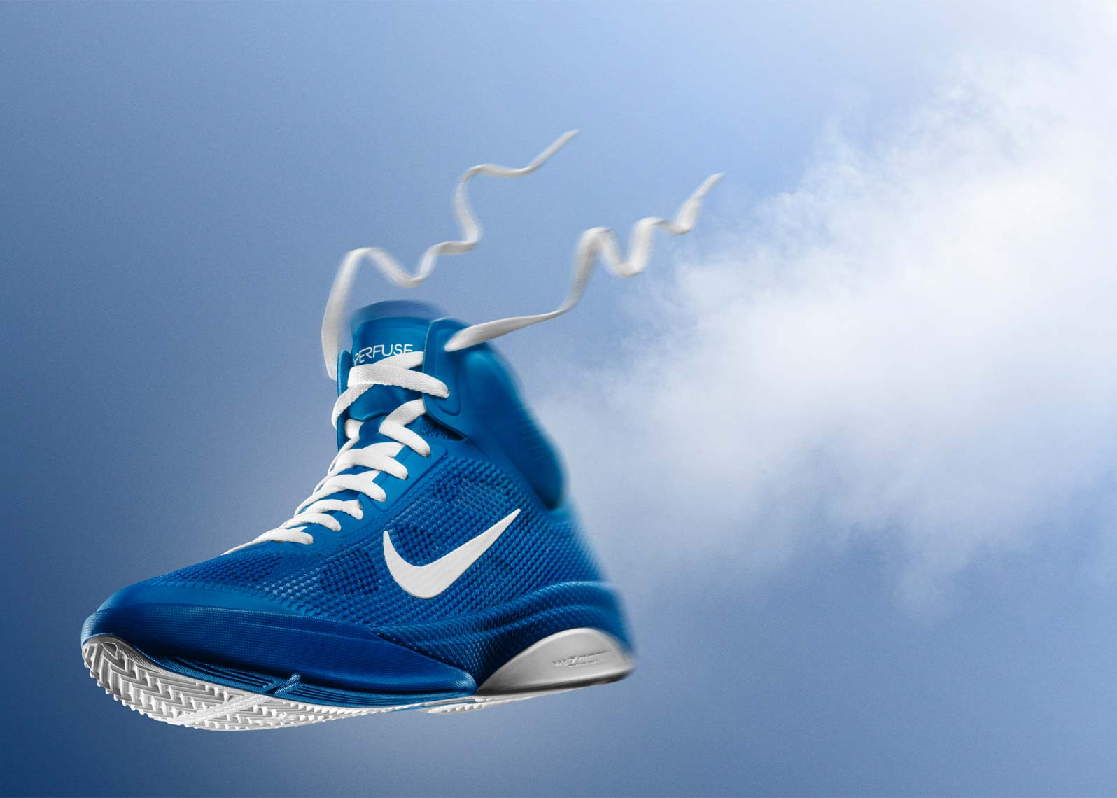 nike basketball hyperfuse shoe on blue background