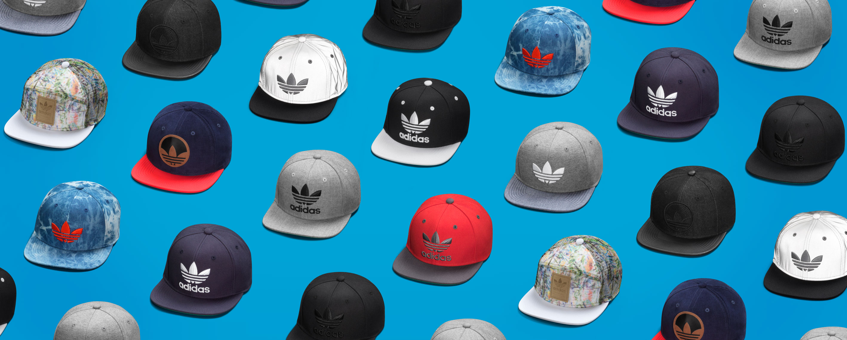 assortment of colorful adidas hats