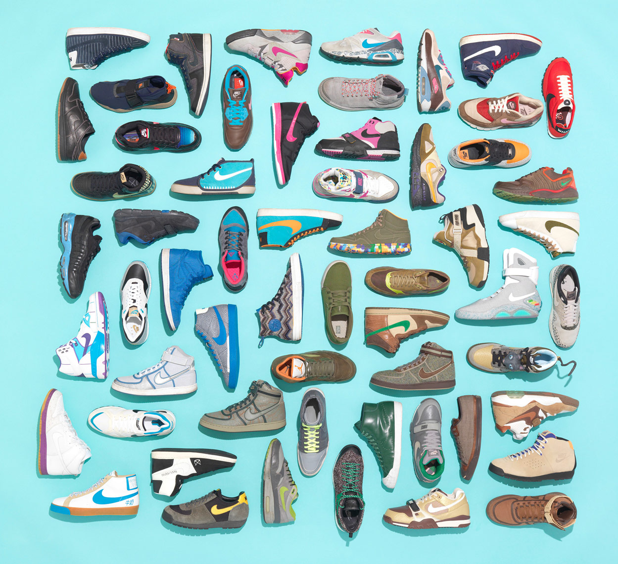 nike sneaker collection artfully arranged neatly on a light blue background