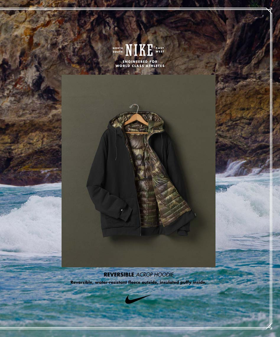 nike surf jacket hanging in front of a clean photo