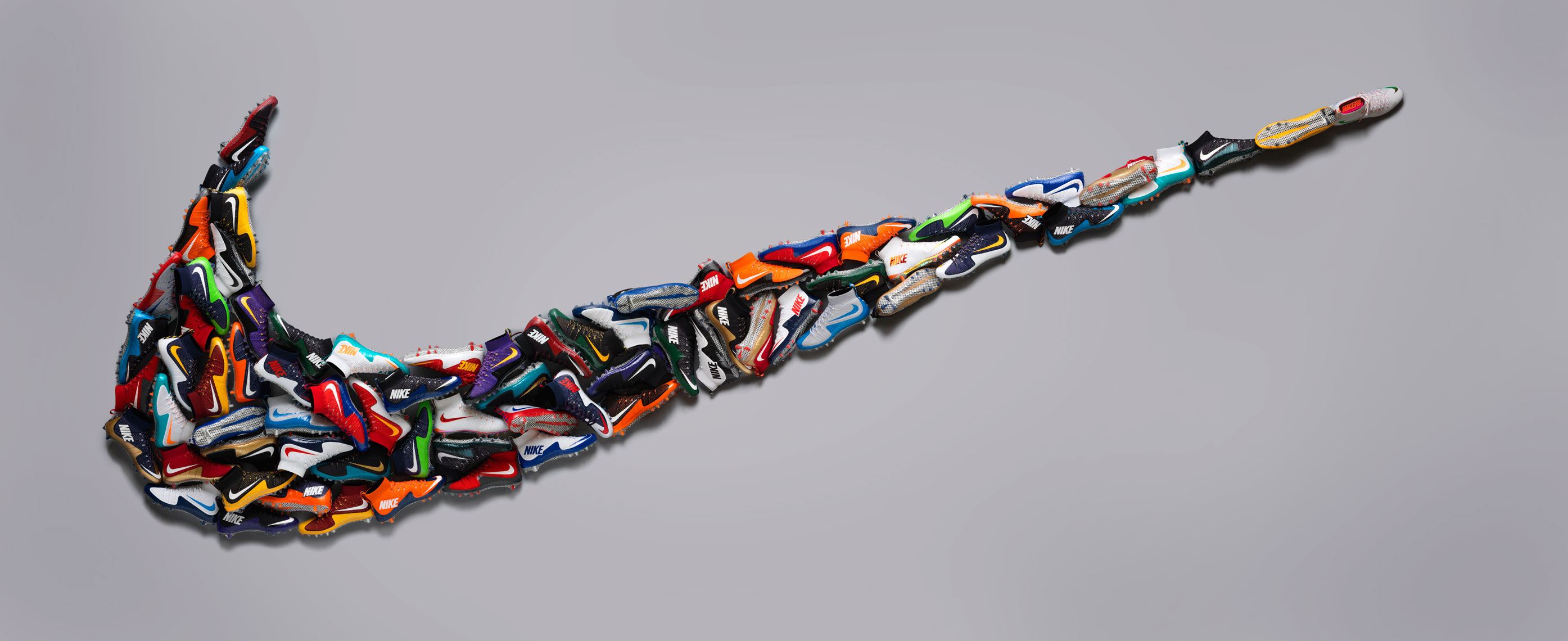 giant nike swoosh made out of nike football cleats