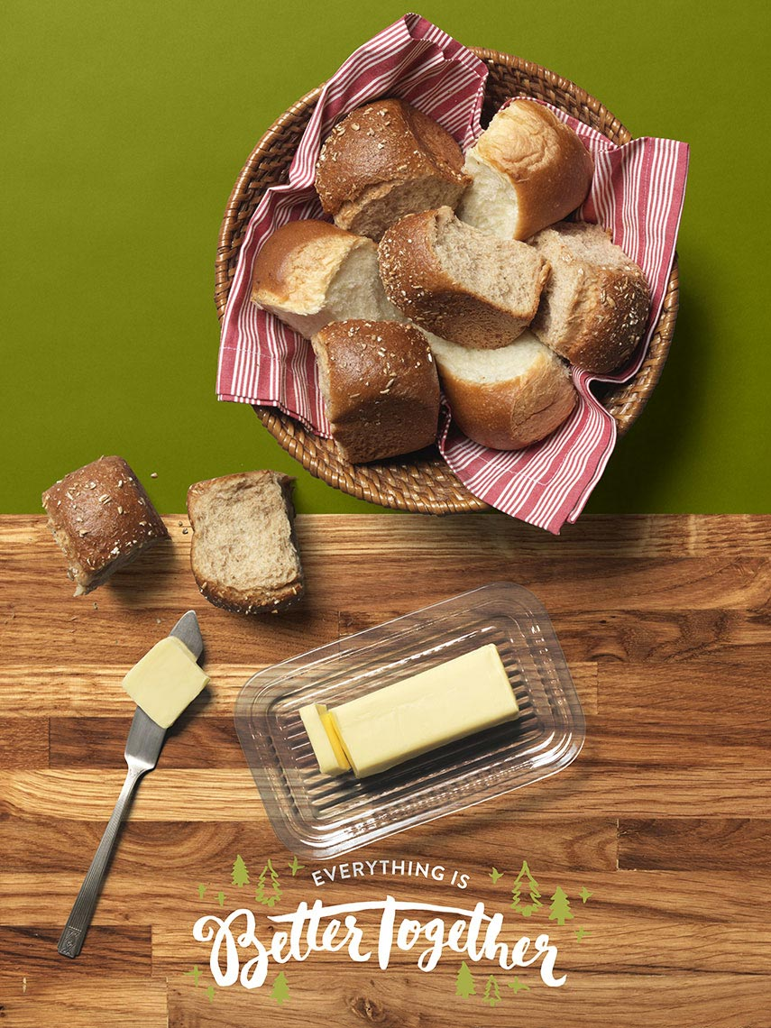basket of bread with a butter dish