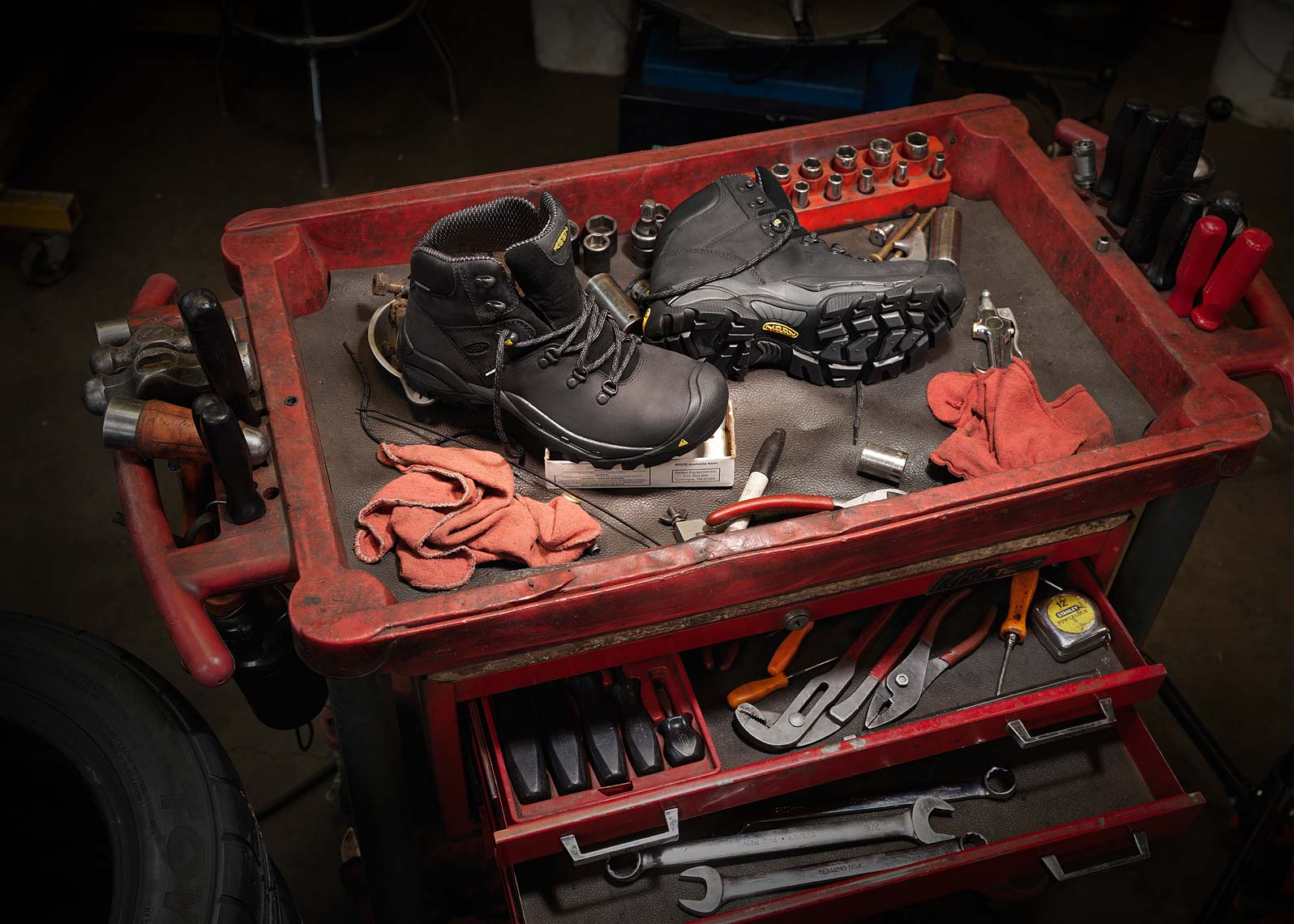 keen boots at mechanic shop red black