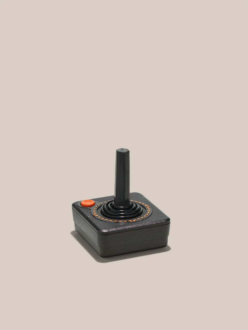 atari joystick on a tan background