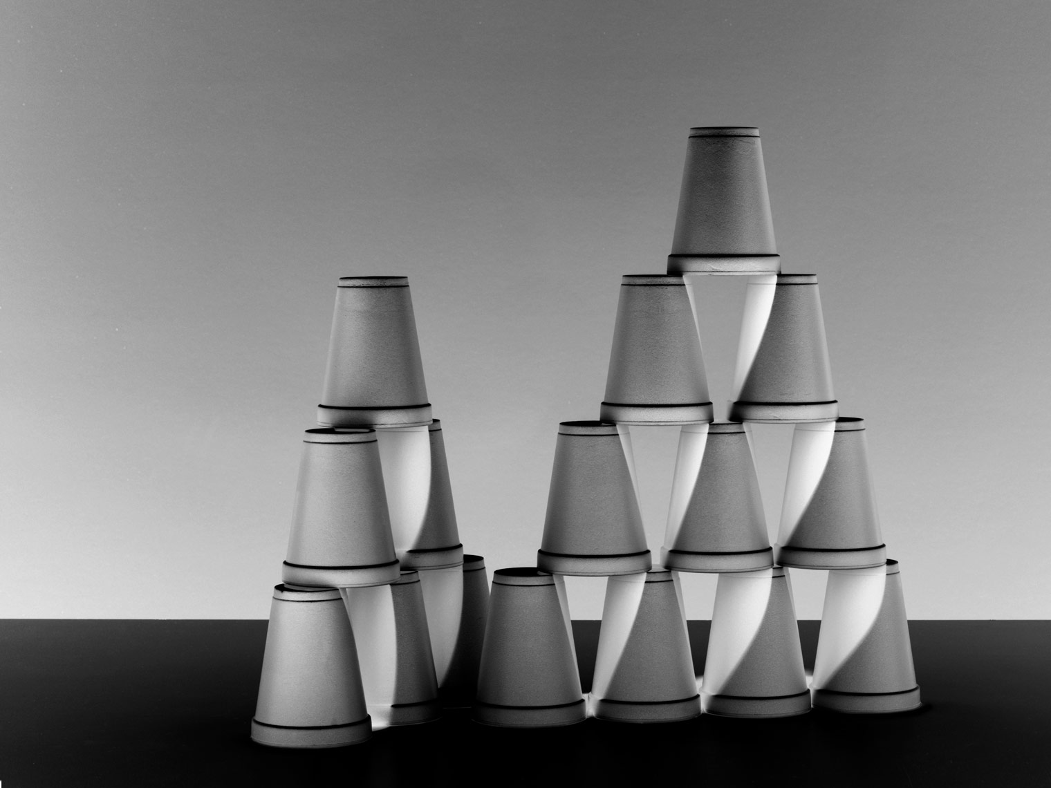 black and white photo of stacked foam cups