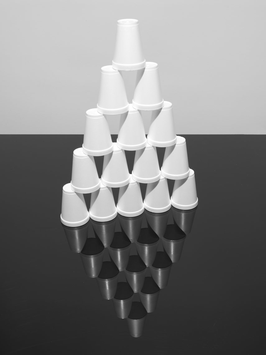 simple stack of styrofoam cups on black plexiglass