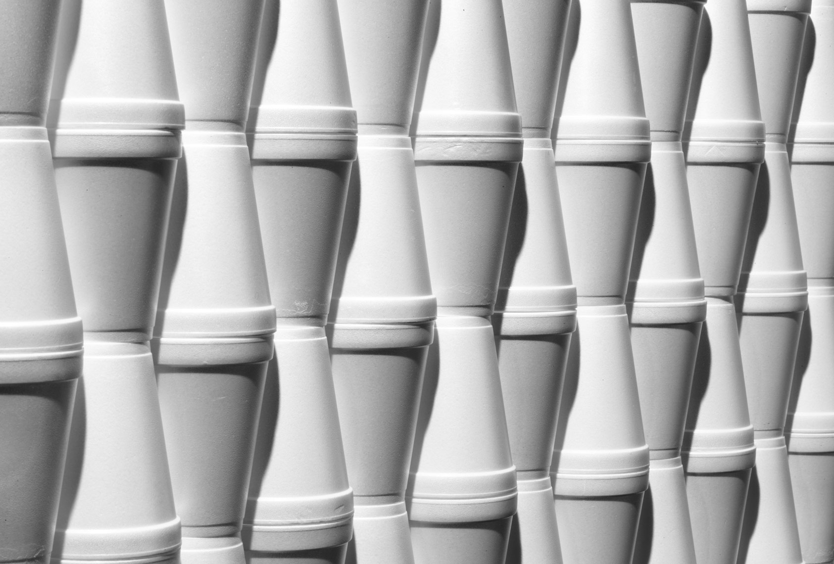 white and black styrofoam cups organized neatly