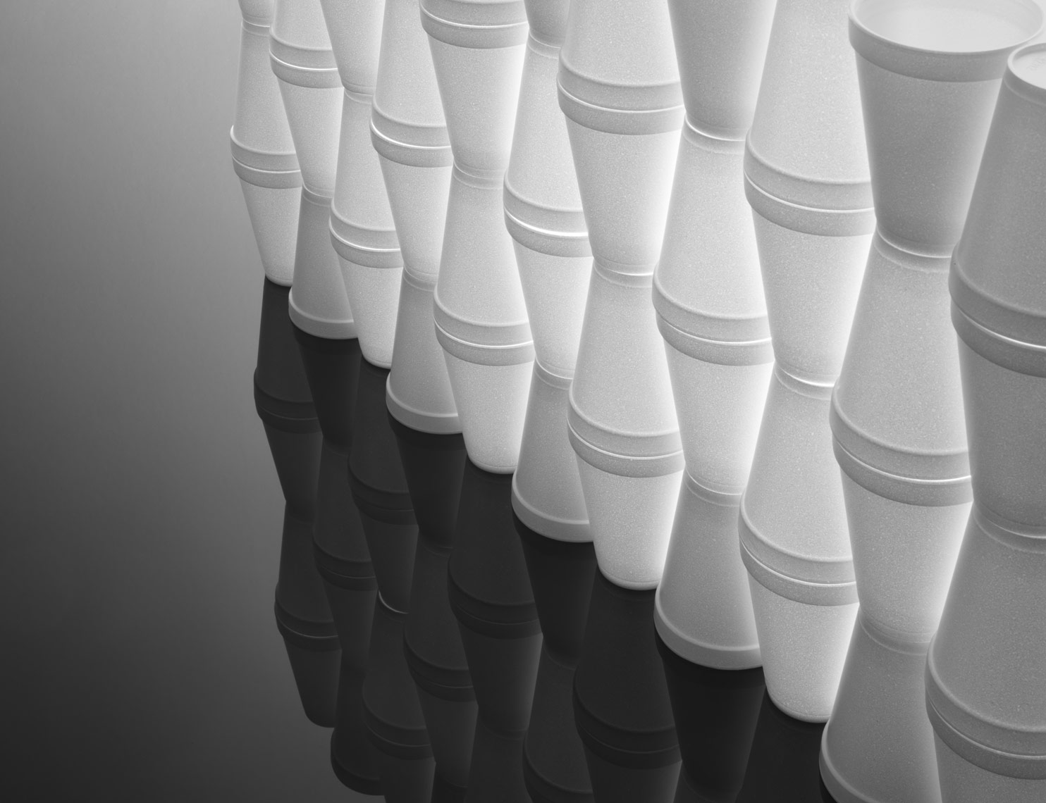 stacked styrofoam cups on black plexiglass