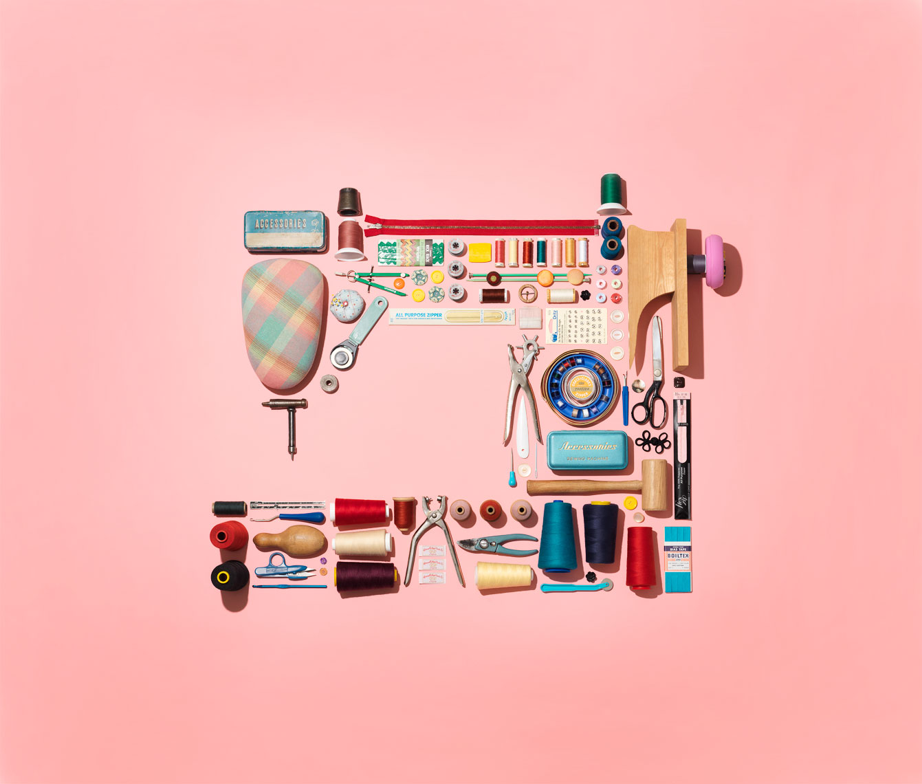 collection  of sewing stuff in shape of a sewing machine