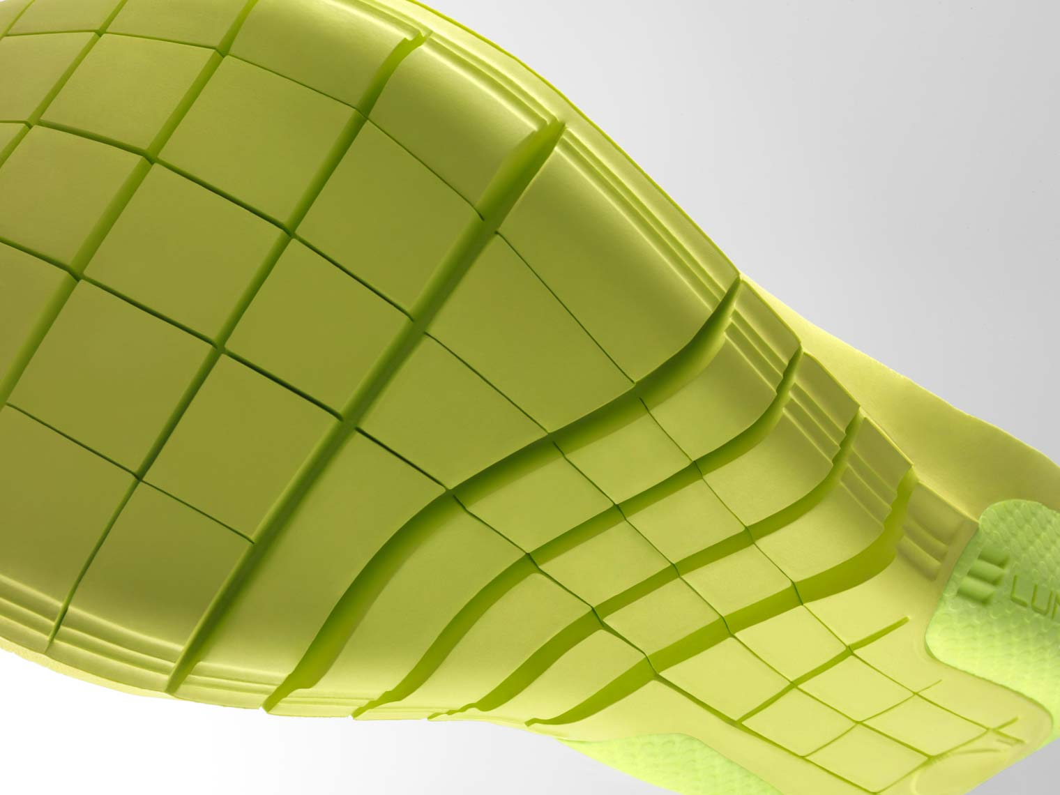 nike lunar lon footbed being twisted on white background