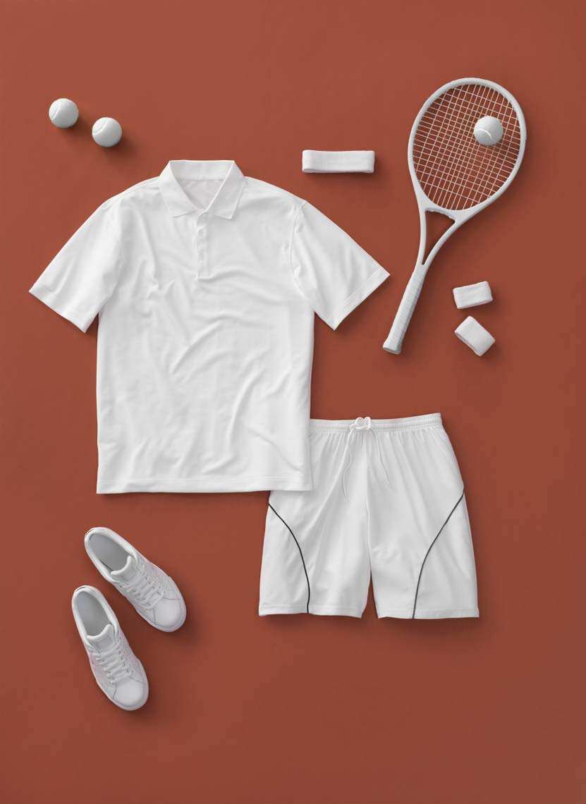 white tennis apparel on clay background
