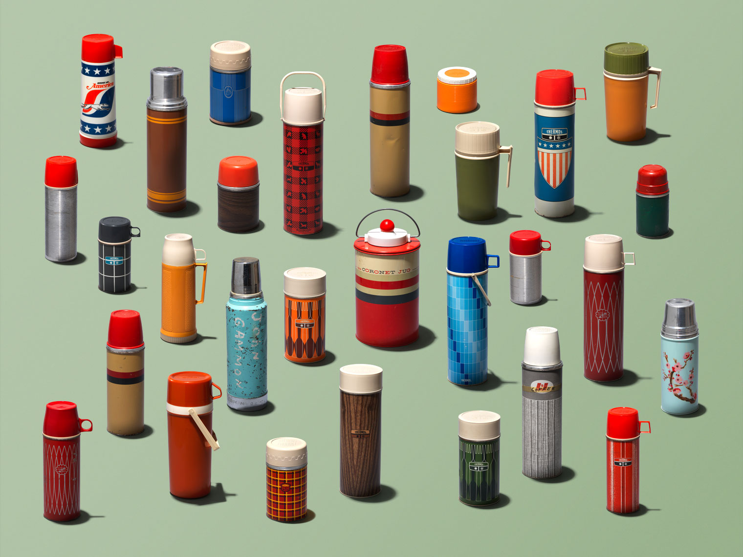 vintage thermos collection on a green background