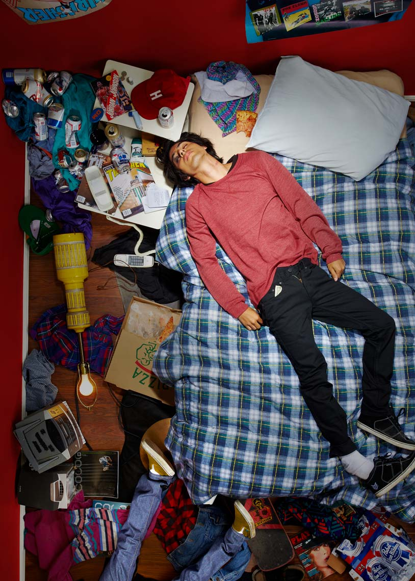 young man passed out in a messy room