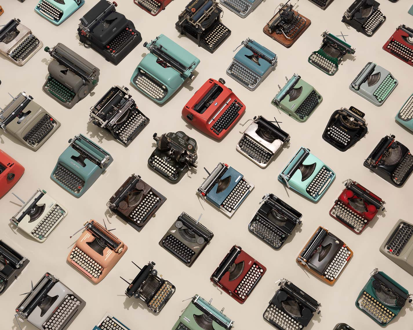vintage typewriters arranged neatly from overhead