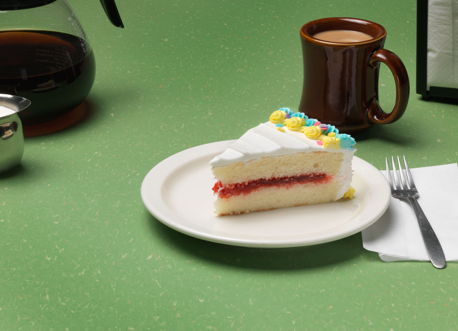 slice of white cake at a diner