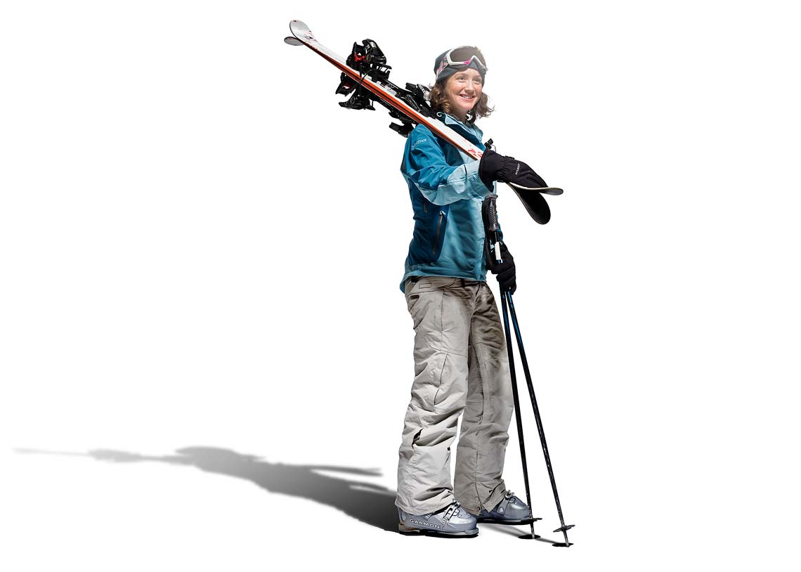woman skier with skis over her shoulder
