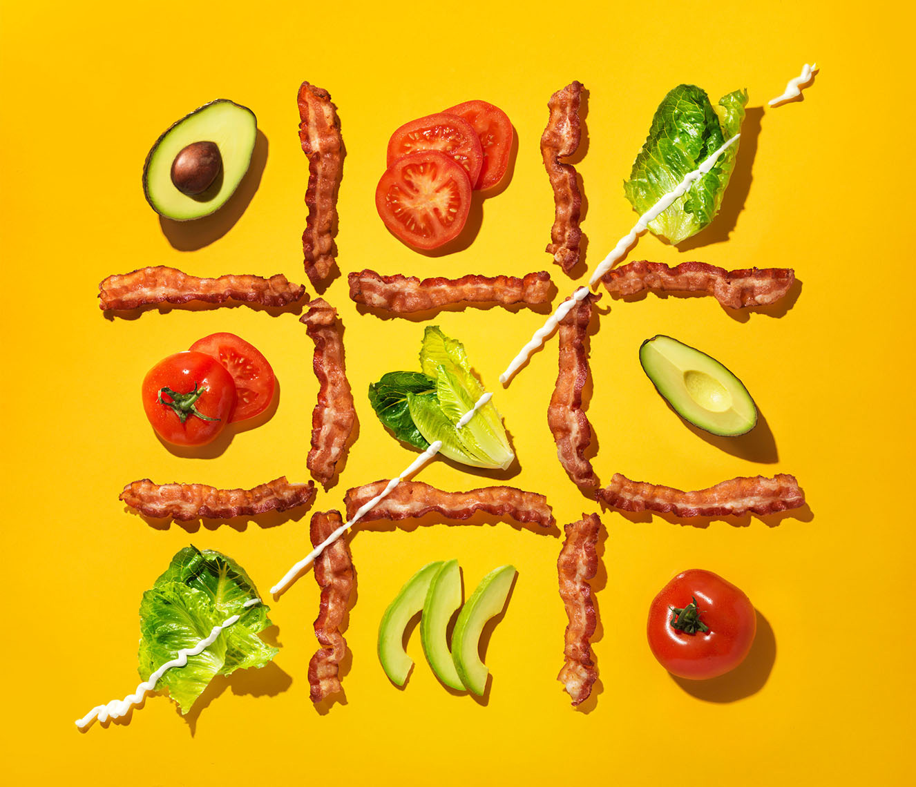 bacon lettuce tomato tic tac toe on yellow