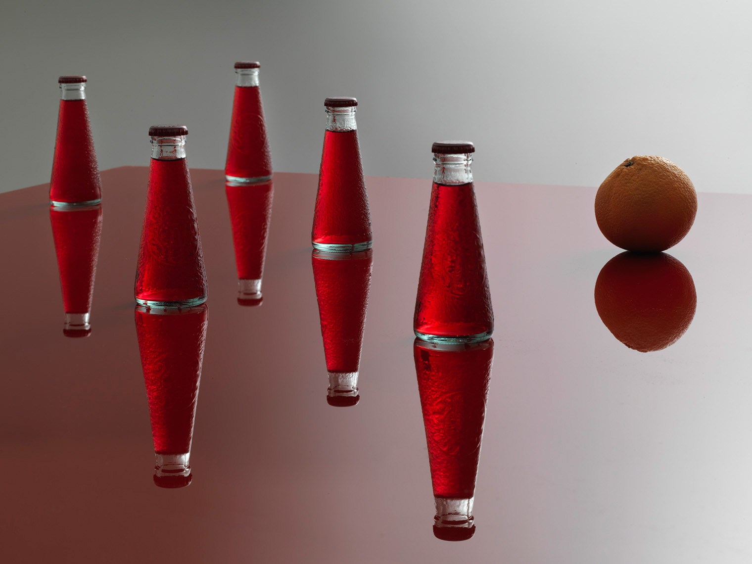 single serve campari and soda on red background