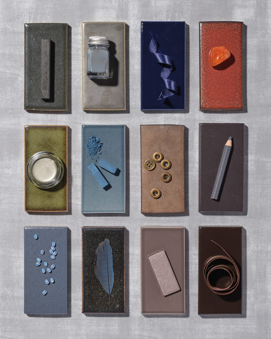 small objects arranged on a dark tile collection for ann sacks tiles